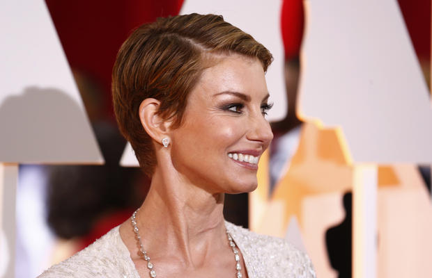 Singer Faith Hill is seen wearing a dress by J Mendel as she arrives at the 87th Academy Awards in Hollywood, California